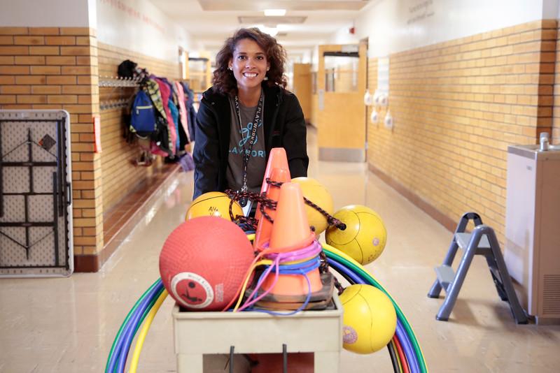 Teacher pushing equipment cart
