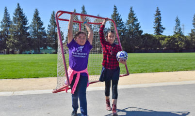 Playworks students set up a soccer game. If you don't have a goal, cones work too.