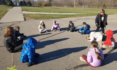students playing on blacktop