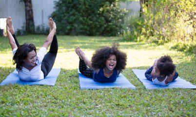 kids and adult doing yoga