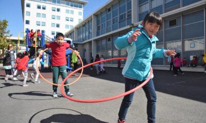 boy and girl with hula hoops