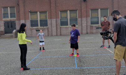 Child leading game on foursquare court